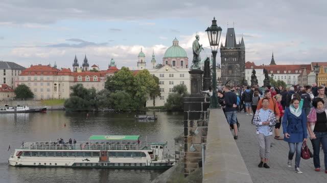 river boats and the vltava from charles bridge, prague, czech republic, europe - river vltava stock videos & royalty-free footage