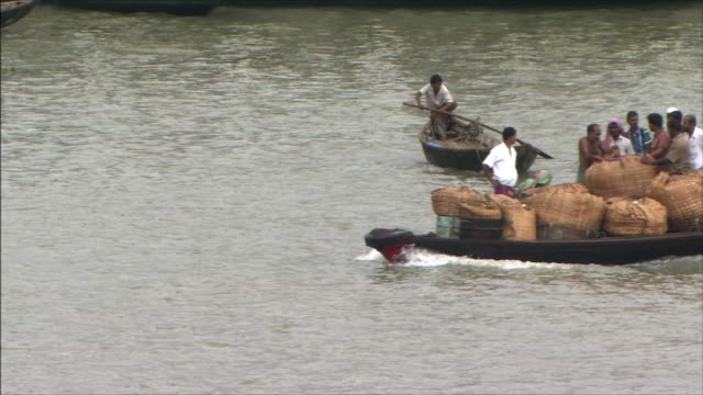 River Boats with packages and people aboard