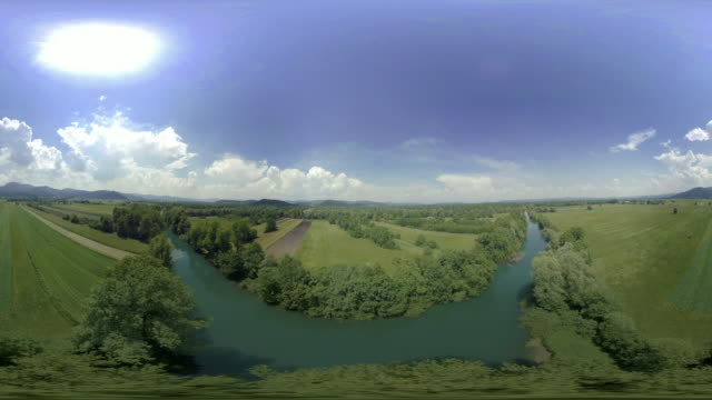 AERIAL VR 360: River crossing the fields and meadows on a sunny day