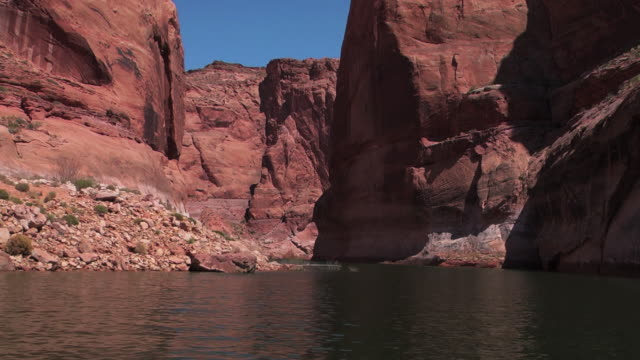 a river cuts though a canyon in nevada. - black canyon stock videos & royalty-free footage