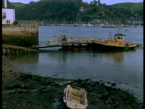 t/l river dart, dartmouth - small river ferry arrives, unloads then loads up again and departs - dartmouth england stock videos & royalty-free footage