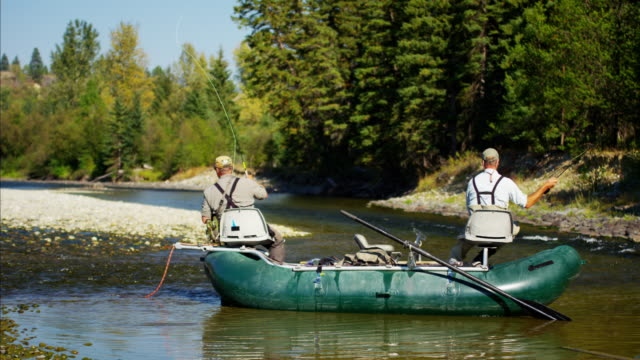 River dingy fly fishing males on freshwater river