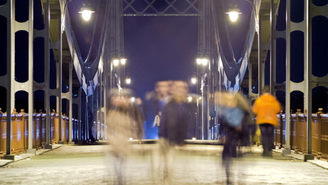 River embankment, bridge and alley at night