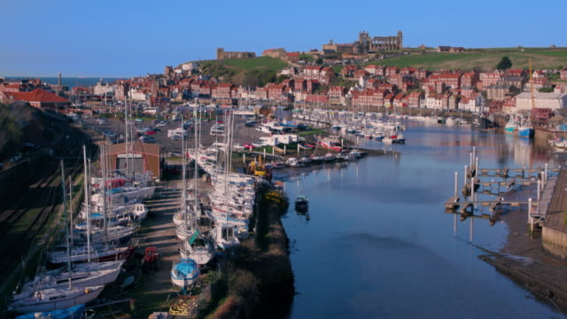 river esk  yachts & town whitby, north yorkshire, england - whitby north yorkshire england stock videos & royalty-free footage