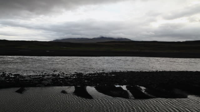 ws river flowing in front of cloud filled mountain / north iceland, skagafjaroarsysla, iceland - solid stock videos & royalty-free footage