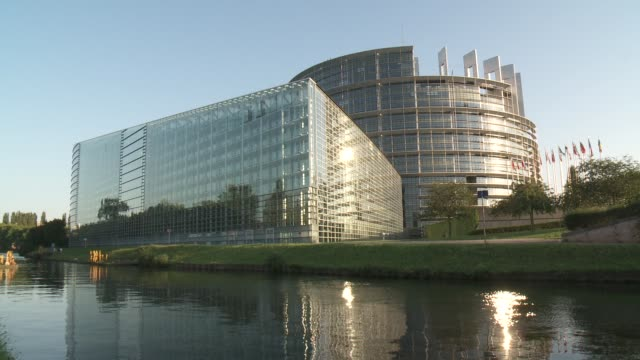 A river flows past the European Union Parliament building in Strasbourg, France.