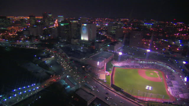 AERIAL, River Front Stadium and cityscape at night, Newark, New Jersey, USA