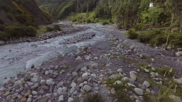 river full of rocks and stones of all sizes in the middle of the vegetation in sorata, la paz / bolivia - la paz bolivia stock videos & royalty-free footage