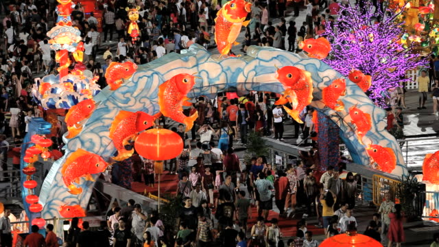 river hongbao decorations for chinese new year celebrations at marina bay, singapore, south east asia - 魚点の映像素材/bロール