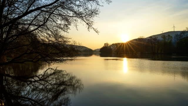 river main at sunrise in spring, collenberg, churfranken, spessart, miltenberg-district, bavaria, germany - バイエルン州点の映像素材/bロール