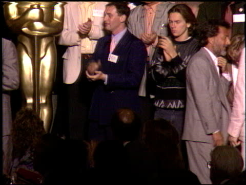 river phoenix at the 1989 academy awards luncheon at the beverly hilton in beverly hills, california on march 21, 1989. - リバー フェニックス点の映像素材/bロール
