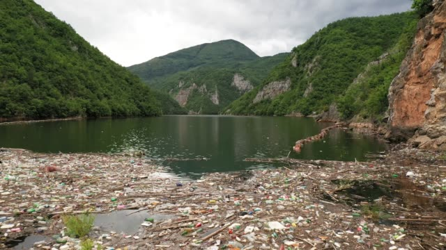 river polluted with garbage - water pollution stock videos & royalty-free footage