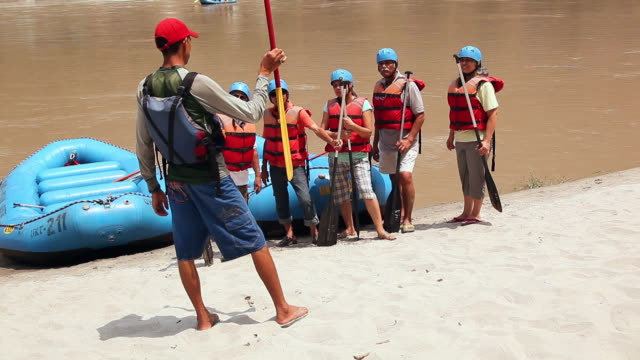 River rafting guide teaching to rafters, Ganges River, Rishikesh, Uttarakhand, India