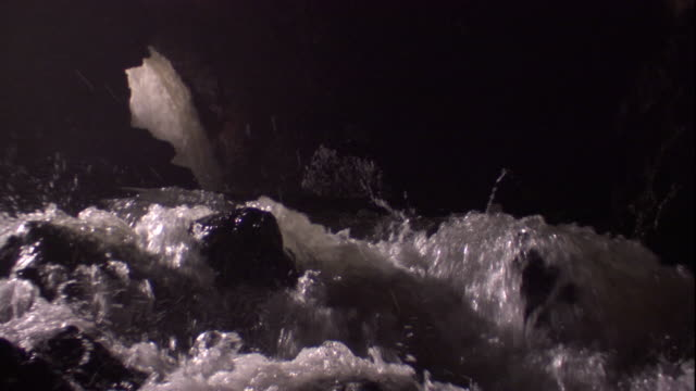 river rapids tumble through a cave and over rocks. available in hd. - cave stock videos & royalty-free footage