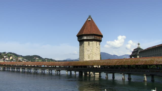 ms, river reuss with chapel bridge and water tower, lucerne, switzerland - circa 14th century stock videos & royalty-free footage
