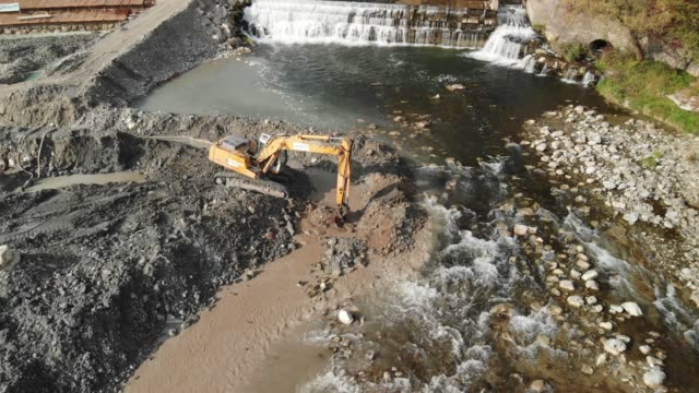 river site construction - building a dam - crane construction machinery stock videos & royalty-free footage