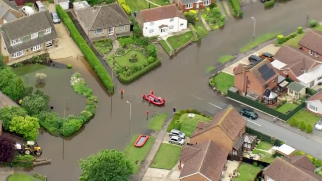 river steeping in lincolnshire bursts its banks as heavy rain continues across country england lincolnshire wainfleet view / aerial flooded suburban... - lincolnshire stock videos & royalty-free footage