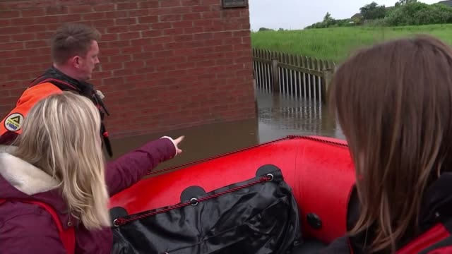 river steeping in lincolnshire bursts its banks as heavy rain continues across country england lincolnshire ext nicole herrington along flooded road... - lincolnshire stock videos & royalty-free footage