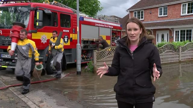 river steeping in lincolnshire bursts its banks as heavy rain continues across country england lincolnshire wainfleet ext reporter to camera sot re... - umgeben stock-videos und b-roll-filmmaterial
