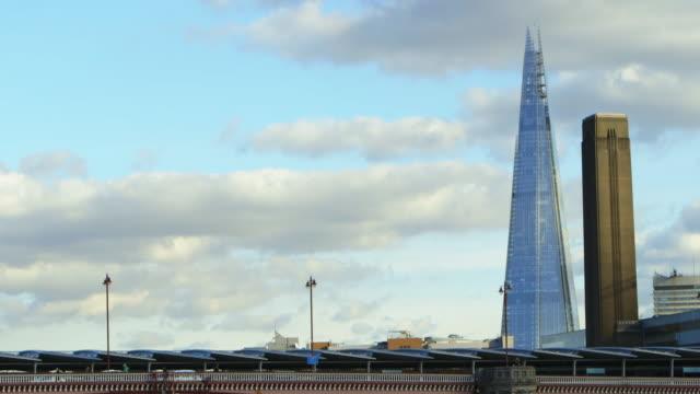 slo mo pov ms river thames and shard london bridge skyscraper / london, england, united kingdom - curtain wall facade stock videos and b-roll footage