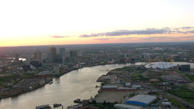river thames flows near canary wharf in london, england. - greater london stock videos and b-roll footage
