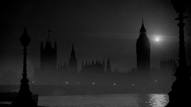 river thames reflects the moon near the houses of parliament on a foggy night in london. - victoria tower stock videos & royalty-free footage