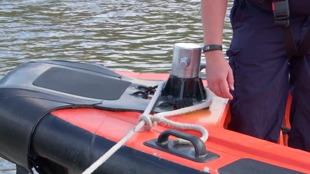 river thames - rnli lifeboat general views and air ambulance general views; england: london: nr chiswick: ext general views of rnli lifeboat crew... - cetacea bildbanksvideor och videomaterial från bakom kulisserna