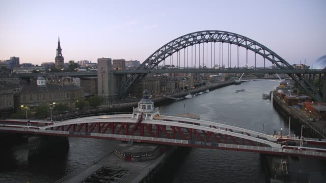 river tyne, spanned by the swing bridge, tyne bridge and millennium bridge, newcastle and gateshead, tyne and wear, england, uk - swing bridge stock videos & royalty-free footage