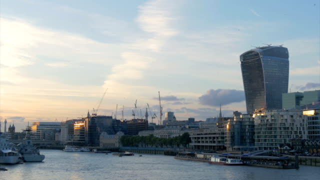 river view of the city of london at dusk with ships - gla building stock videos & royalty-free footage