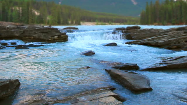 river waterfalls in the mountain park - athabasca falls stock videos and b-roll footage