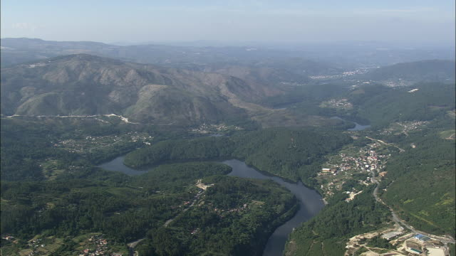 aerial ws river wiggling through countryside / aldea de abajo, galicia, spain - galicia stock videos & royalty-free footage