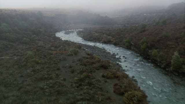 aerial river winding through rangipo desert scrubland thick with grasses and brush / manawatu-wanganui, new zealand - tongariro national park stock videos & royalty-free footage