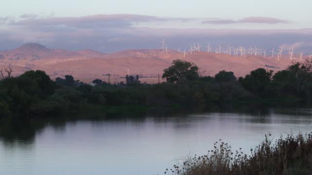 river & windmills again - wiese stock videos & royalty-free footage