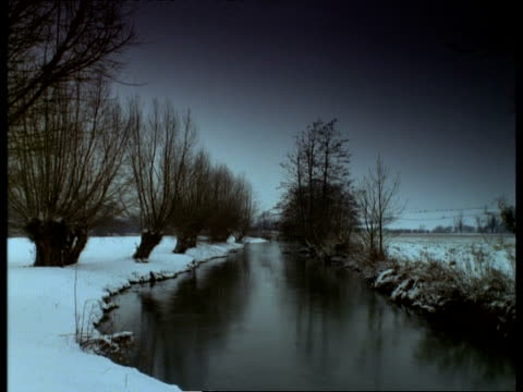 t/l river windrush in snow, january, lapse time - windrush river stock videos and b-roll footage