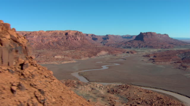 a river winds through the desert near lake powell, utah. - lake powell stock videos & royalty-free footage