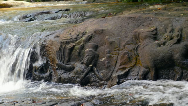 river with engravings with water flowing - angkor stock videos and b-roll footage