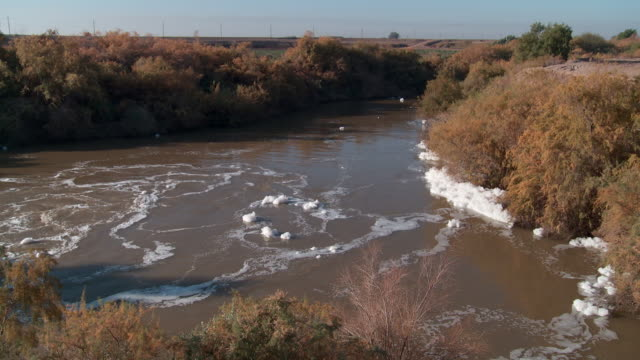 WS River with foam from factory pollution