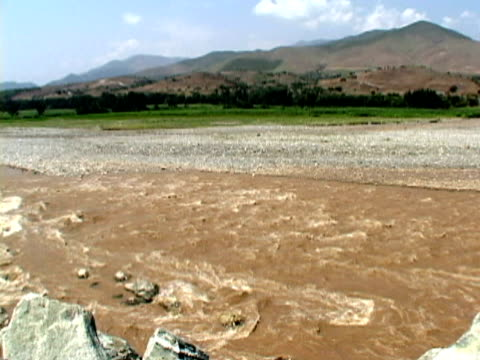 WS PAN River with mountains and vegetation in background, Nangarhar, Afghanistan