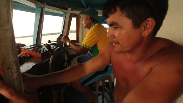 riverboat crew members ride along the tapajos river during a 'caravan of resistance'' protest by indigenous groups and supporters who oppose plans to... - para state stock videos & royalty-free footage
