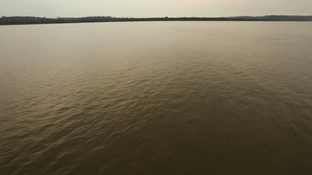 a riverboat moves along the tapajos river during a 'caravan of resistance'' protest by indigenous groups and supporters who oppose plans to construct... - para state stock videos & royalty-free footage