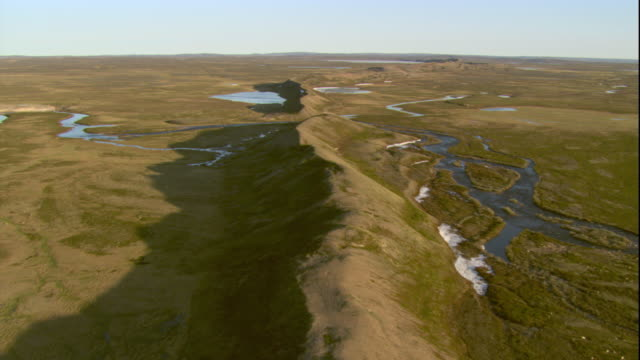 rivers and streams flow along a hilly ridge across the tundra. available in hd. - ridge stock videos and b-roll footage