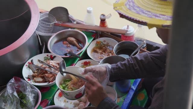 riverside cooking at the damnoen saduak floating river market, bangkok, thailand, southeast asia, asia - bangkok stock videos & royalty-free footage