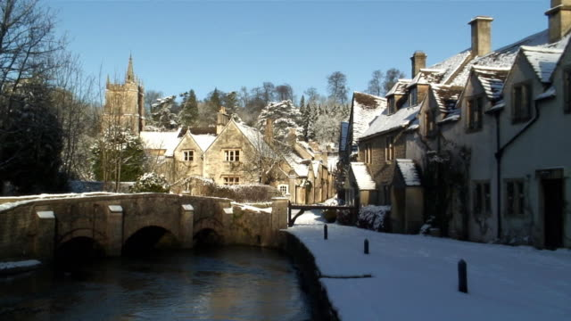 cu zo ws riverside houses in snow / castle coombe, wiltshire, england - cotswolds stock videos & royalty-free footage