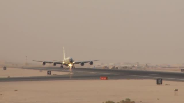 rivet-joint-reconnaissance-aircraft-flight-operations-at-al-udeid-ab-video-id516812192