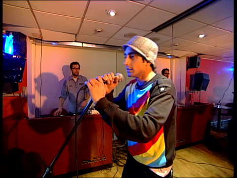rizwan ahmed controversial lyrics england london bbc radio 1 asian network int dj bobby friction speaking on air in radio studio as introducing track... - sketch comedy stock videos & royalty-free footage