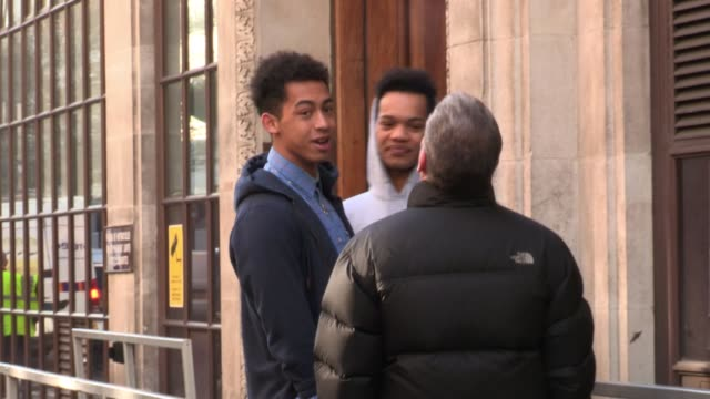 rizzle kicks, , enjoy a cigarette with chris moyles during a break in the show at bbc radio one. sighted: rizzle kicks & chris moyles at bbc radio,... - bbc radio stock videos & royalty-free footage