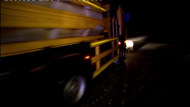 road accidents in cumbria caused by bad weather; england: yorkshire: cumbria: ext/night snow plough along at night 'road closed' notice on snow... - road closed englisches verkehrsschild stock-videos und b-roll-filmmaterial