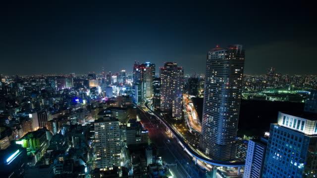 T/L WS HA Road, air, train and Yurikamome line aerial metro traffic in Hamamatsusho area, Tokyo, Japan