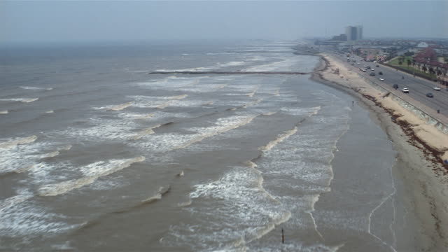 aerial road along shoreline  galveston  texas  usa - gulf coast states stock-videos und b-roll-filmmaterial