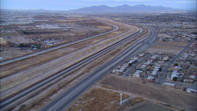AERIAL Road along US-Mexican border at El Paso, Texas, USA